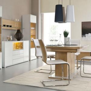 Jadalnia Bianco marki Paged Meble prezentuje ciekawy stół na grubej nodze, z laminowanym, białym blatem. Fot. Paged Meble