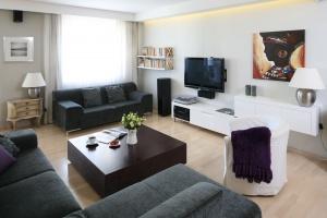 Jak zagospodarować ścianę z telewizorem - 15 inspiracji