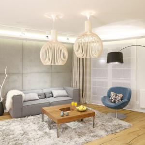 Designerski mebel to podstawa w nowoczesnym salonie. W tym wnętrzu postawiono na fotel znanej duńskiej marki. Projekt Agnieszka Hajdas-Obajtek. Fot. Bartosz Jarosz