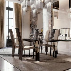 Stół Belle Epoque marki Reflex z hebanowym blatem o grubości 40 mm i błyszczącymi, lakierowanymi nogami zdobionymi złotymi elementami. Fot. Galeria Mebli Heban