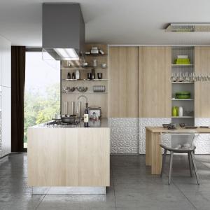 Połączenie kuchni z salonem sprawi, że zyskamy wrażenie swobody, otwarcia i większej przestrzeni. Fot. Komandor