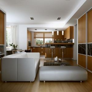 Podczas łączenia salonu i kuchni warto pamiętać o tym, aby wszystkie meble były w podobnym stylu i stanowiły niejako kontynuację we wnętrzu. Fot. Komandor