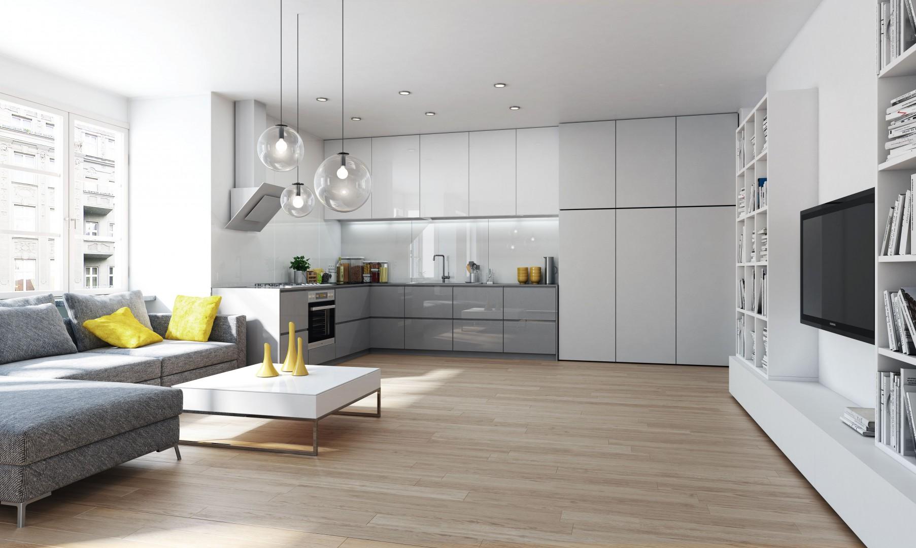W małych mieszkaniach powinny przeważać jasne barwy, które optycznie powiększają przestrzeń - zarówno salonu, jak i kuchni. Fot. Komandor