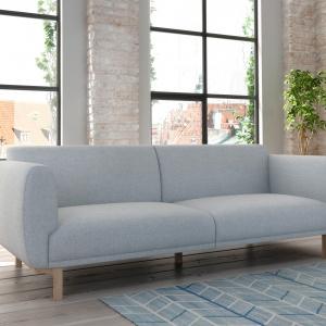 Sofa Enna. Model inspirowany latami 60., o charakterystycznej, obłej lini. Uwagę przyciągają charakterystyczne i drewniane nóżki zwężane ku dołowi. Fot. Adriana Furniture