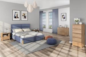 Modna sypialnia. Łóżka z eleganckim zagłówkiem