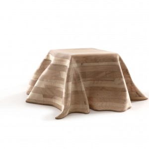 Ten nietypowy mebel został wykonany z dużego kawałka cyfrowo frezowanego drewna. Fot. Porro