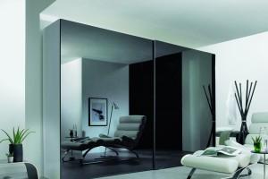 Szafy z dużymi frontami - sposób na aranżację eleganckiego wnętrza