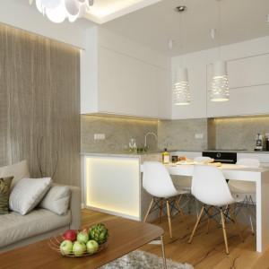 Elegancka biała kuchnia wraz z częścią jadalnianą płynnie łączą się z salonem. Projekt Agnieszka Hajdas-Obajtek. Fot. Bartosz Jarosz