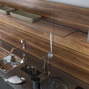 """Dekory orzechowe wyglądają szczególnie efektownie w kuchniach, gdy zestawi się je z kamieniem lub betonem. Na zdjęciu: """"Orzech Verbania"""" firmy Impress Decor. Fot. Impress Decor"""