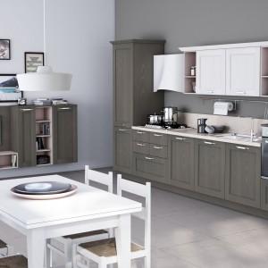 Szarość i biel tej kuchni pojawia się również w części jadalnej i salonowej. Fot. Lube