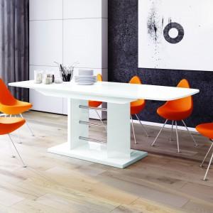 """Stół """"Linosa"""" - wysokopołyskowa płyta, z której wykonano blat sprawia, że mebel wygląda lekko, pomimo dużych rozmiarów i wkładki ukrytej w środku. Fot. Hubertus Design"""
