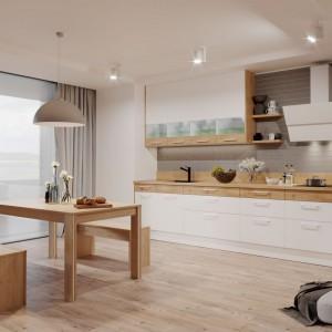Drewno to skuteczny sposób, aby przełamać chłodną stylistykę bieli i ocieplić wnętrze, które wygląda lekko i świeżo, a przy tym również przytulnie. Fot. Kam