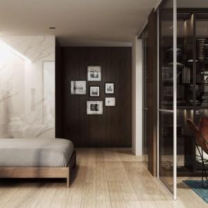 Ruchomą ścianką można oddzielić część sypialną od reszty pomieszczenia. Fot. Komandor