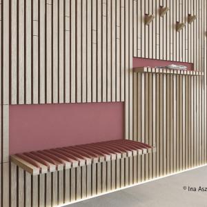 W tym miejscu wieszaki i ławki są dyskretnie ukryte za listwami. Projekt: Ina Aszkiełowicz. Fot. Hettich/Rehau