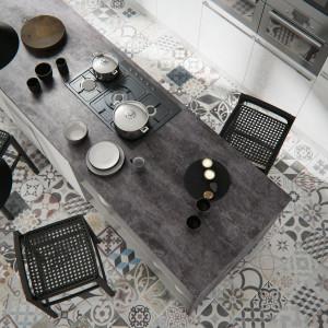 Kuchnia utrzymana w stylu loftowym z blatem wykończonym dekorem