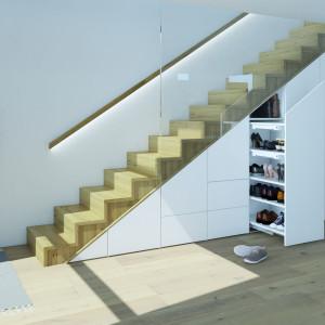 Zabudowując odpowiednio przestrzeń pod schodami, można tam stworzyć wiele praktycznych miejsc do przechowywania. Fot. Hettich