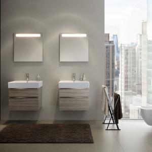 """W nowoczesnych łazienkach coraz większą popularnością cieszą się dekory inspirowane rysunkiem drewna. Na zdjęciu: kolekcja """"Metropolitan"""" marki Opoczno. Fot. Opoczno"""