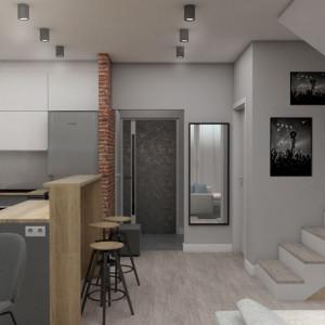 Miejsca do przechowywania nigdy za wiele. Wychodząc z tego założenia, na pojemne schowki wykorzystano również przestrzeń pod prowadzącymi na piętro schodami. Projekt: Małgorzata Górska-Niwińska (Pracownia Architektoniczna MGN).