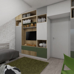 Pokój młodszego syna właścicieli jest na równi efektowny i funkcjonalny. Całą długą ścianę od podłogi do sufitu zajmuje zabudowa z szafami, szafkami o otwartymi półkami. Realizacja - Pracownia Architektoniczna MGN