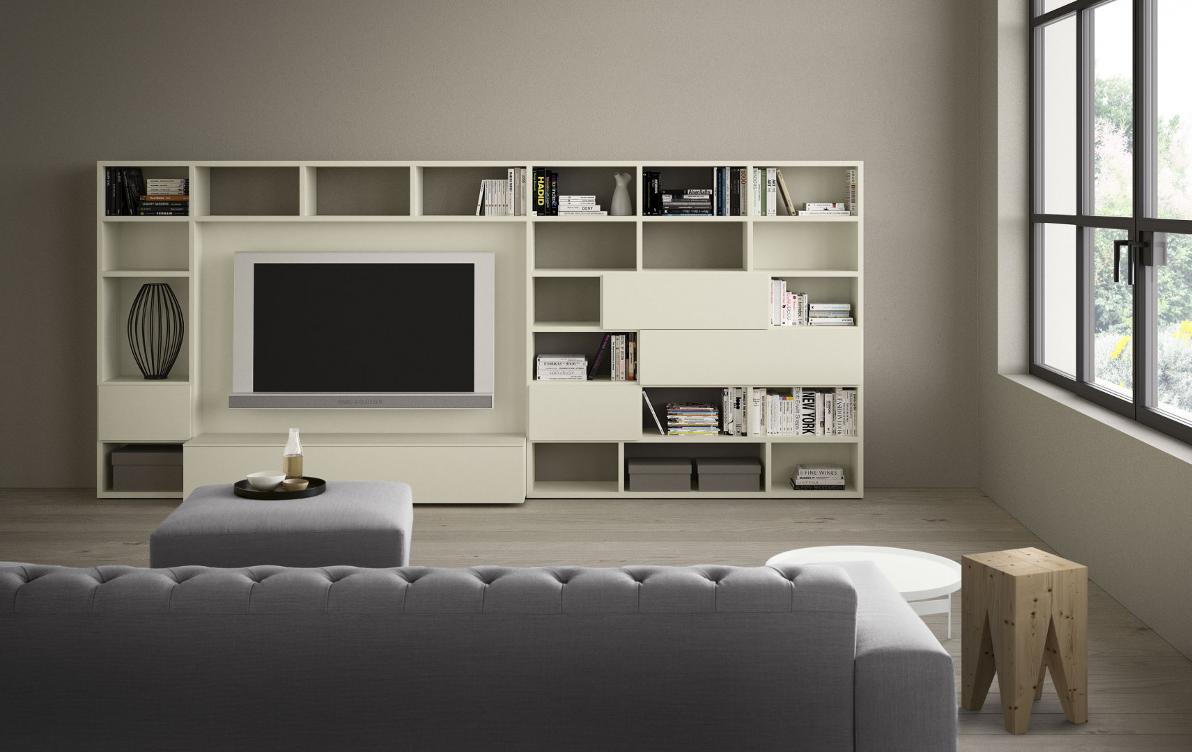 Biała biblioteczka z miejscem na telewizor. Fot. Pianca