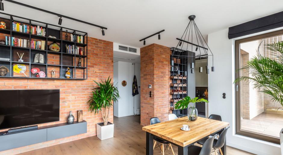 Jak urządzić apartament w stylu loft z elementami hygge?