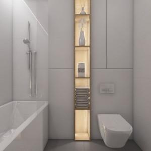 . Zabudowana wnęka na sedesem jest niewidoczna, bo zlewa się z tłem ścian. W oczy rzuca się natomiast słupek z podświetlanymi półkami - wielka ozdoba tej łazienki. Fot. Pracownia MGN