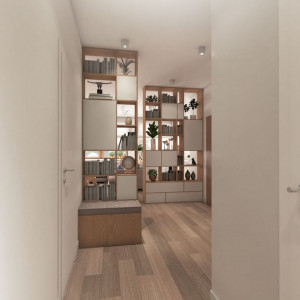Aby strefa dzienna była jak najbardziej obszerna, właściciele tego mieszkania zdecydowali się otworzyć salon nie tylko na kuchnię, ale i  na przedpokój. Na granicy tego pomieszczenia z kuchnią i jadalnią postawiono ażurowe regały (przy jednym zbudowano ławeczkę ze schowkiem na buty), które zasłaniają okolicę drzwi wejściowych, zapewniają dużo miejsca na książki i różne drobiazgi, nie ograniczając zarazem przestrzeni. Projekt: Pracownia Architektoniczna MGN. Fot. Pracownia Architektoniczna MGN