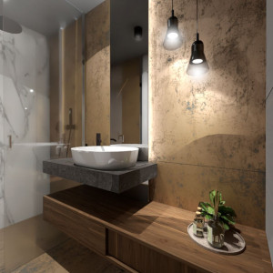 W łazience na parterze ściany również wyłożono spiekiem kwarcowym. Okładzina w kabinie prysznicowej wygląda jak z marmuru. To właśnie ten materiał w głównej mierze decyduje o urodzie tego wnętrza. Zadbano też o funkcjonalność tego pomieszczenia. Jest tu łatwy dostęp do wszystkich urządzeń sanitarnych i schowki, w których można ukryć to, co nie powinno leżeć na widoku. Na nie wykorzystano każdą wolną przestrzeń, między innymi we wnęce, powstałej po obudowaniu instalacji podwieszonego sedesu. Projekt: Małgorzata Górska-Niwińska. Fot. Pracownia Architektoniczna MGN